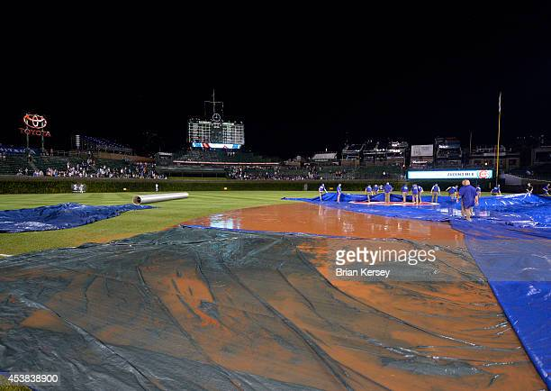 A downpour left standing water in the infield preventing the grounds crew from getting the tarp on the field after play was suspended in the fifth...