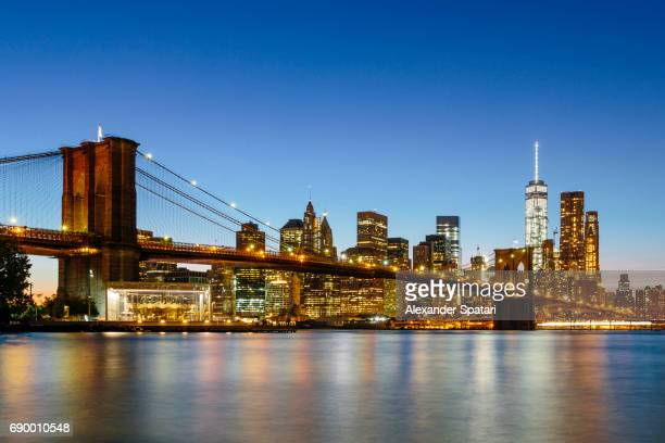 Downtown and Brooklyn Bridge illuminated at night, Manhattan, New York City, USA