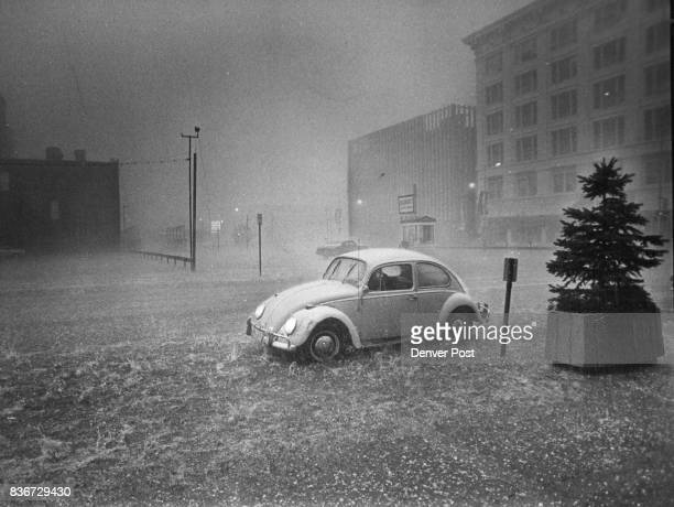 Downtown buildings were nearly obliterated by sheets of rain at height of Sunday storm Water floods the street and covers the curb on California...