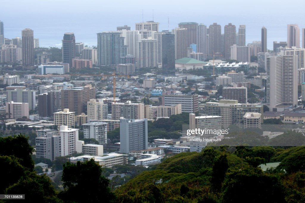 Downtown city buildings with ocean beyond : Stock Photo