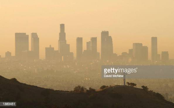 Downtown highrise buildings are shown cloaked in dirty air shortly after sunrise September 11 2002 in Los Angeles California Although air quality in...