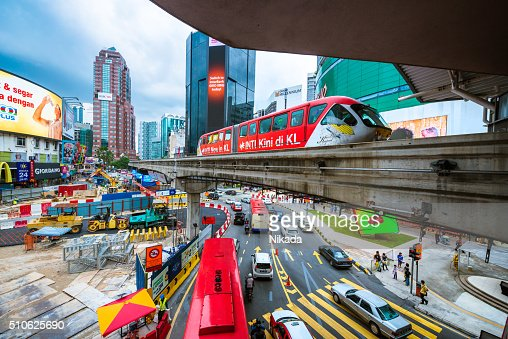 Downtown Kuala Lumpur with road, train, billboards and cars
