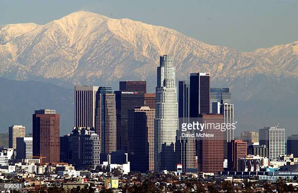 Downtown Los Angeles is left with a backdrop of snow on the San Gabrial Mountains after a storm from the the Gulf of Alaska brought snow to the state...