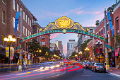 Downtown San Diego Gaslamp sign over moving traffic