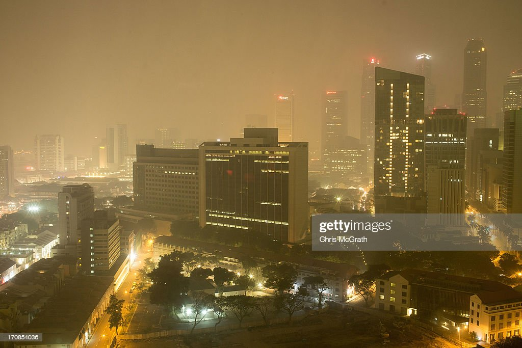 Downtown Singapore is covered in thick smoke haze on June 19, 2013 in Singapore. The Pollutant Standards Index (PSI) rose to the highest level on record registering at 321 at 10pm.The haze is created by deliberate slash-and-burn forest fires started by companies in neighbouring Sumatra.