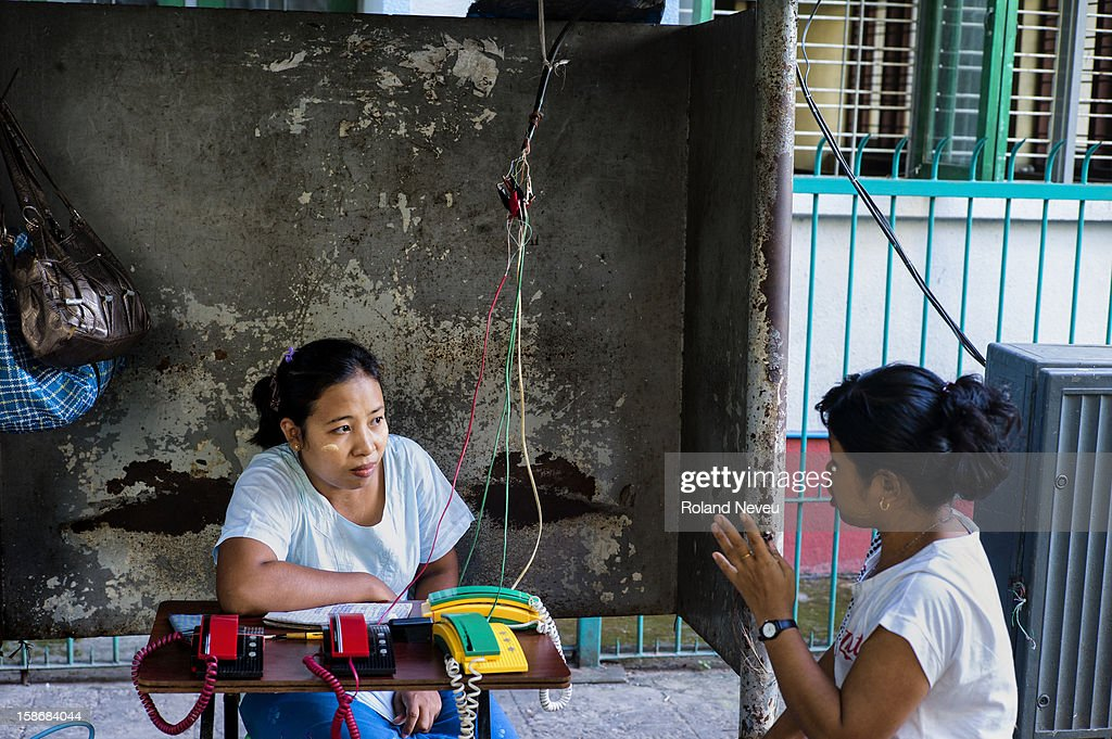 Downtown the old Yangon, a woman have set-up a telephone business by simply hijacking the local network and setting up a few phones on a table..