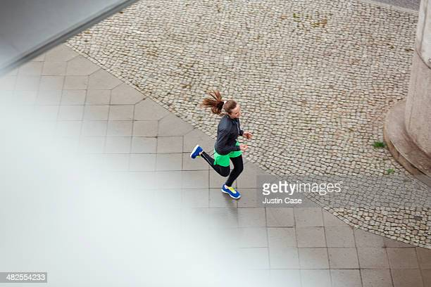 downward view of a young sporty running woman
