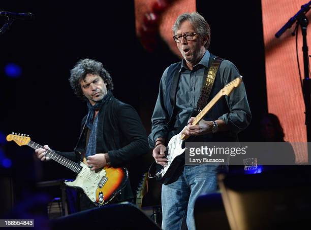 Doyle Bramhall and Eric Clapton perform on stage during the 2013 Crossroads Guitar Festival at Madison Square Garden on April 13 2013 in New York City