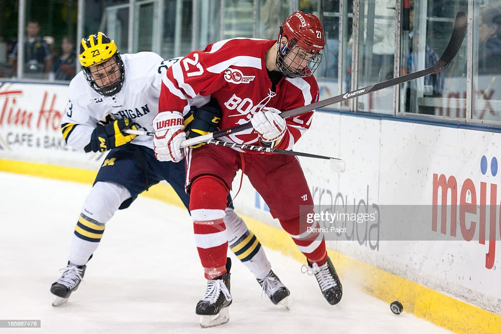 Doyle Somerby #27 of the Boston University Terriers battles against Alex Kile #23 of the Michigan Wolverines on October 25, 2013 at Yost Ice Arena in Ann Arbor, Michigan.