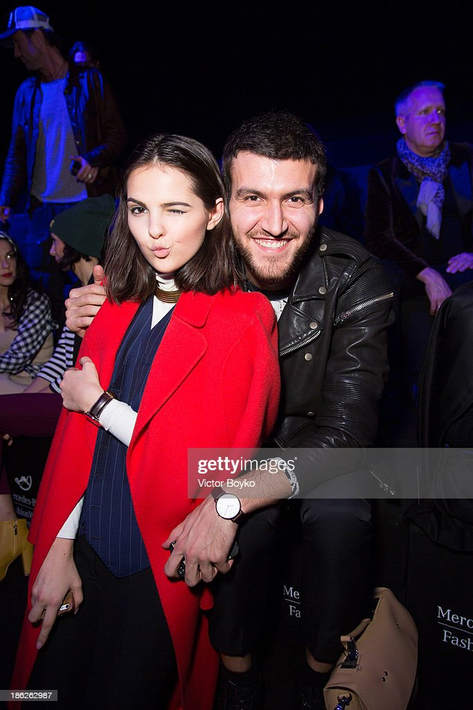 Doyna Ciobanu and Magomed Umkhaev attend the Muscovites by Mashsa Kravtsova show of Mercedes-Benz Fashion Week S/S 14 on October 29, 2013 in Moscow, Russia.