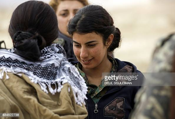 Doza Jiyan a 21yearold female Arab fighter among the Syrian Democratic Forces made up of USbacked Kurdish and Arab fighters talks with other fighters...