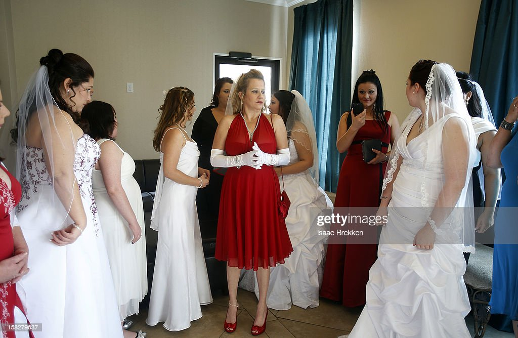 A dozen brides wait to be married during a ceremony for a radio station contest at the Little Chapel of the Flowers on December 12, 2012 in Las Vegas, Nevada. Couples around the world are hoping that a once-in-a-lifetime event, the date 12/12/12, will bring added luck to their marriages if they tie the knot today. This will be the last such triple date for almost a century, until January 1, 2101.