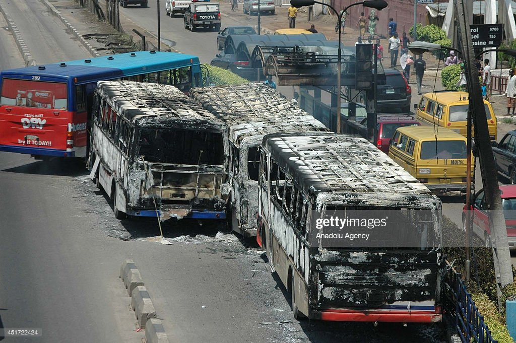Dozen of Nigerian soldiers go on a rampage and burn public transport buses on July 4, 2014 in commercial capital Lagos after a public transport bus ran over a soldier on a motorcycle according to eyewitnesses, in Lagos, Nigeria.