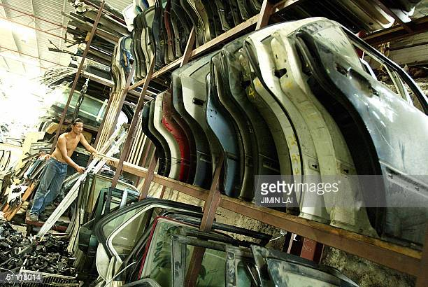 Dozens of car doors are stacked on shelves at a spare parts dealer in Kuala Lumpur 27 July 2004 Vehicle sales in Malaysia are expected to hit a...