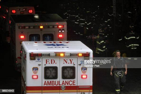 Dozens of firefighters attend to the injured following the crash of the Staten Island Ferry into a dock in the city's borough of Staten Island on May...