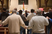 Dozens of gay catholics hold an evening mass at the St Margaret's Episcopal Church in Washington DC on October 27 2013 For more than 40 years a group...