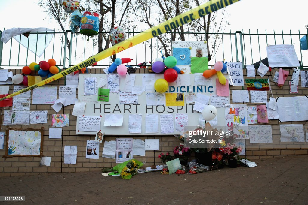 Dozens of hand-made messages of support for former South African President Nelson Mandela are posted to the wall outside the Mediclinic Heart Hospital June 25, 2013 in Pretoria, South Africa. South African President Jacob Zuma confirmed Sunday that Mandela's condition has become critical since he was admitted to the hospital over two weeks ago for a recurring lung infection.