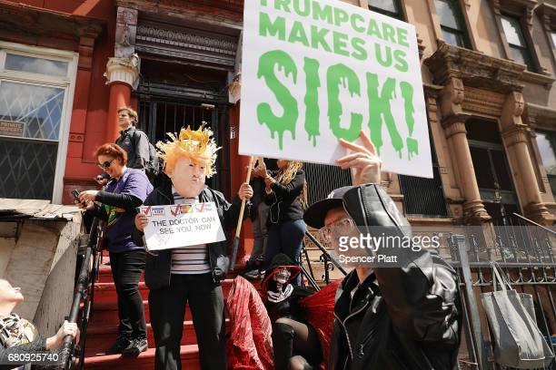 Dozens of health care activists protest in front of a Harlem charter school before the expected visit of House Speaker Paul Ryan on May 9 2017 in New...