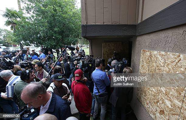 Dozens of members of the media stand in front of the home of shooting suspect Syed Farook on December 4 2015 in Redlands California Dozens of members...