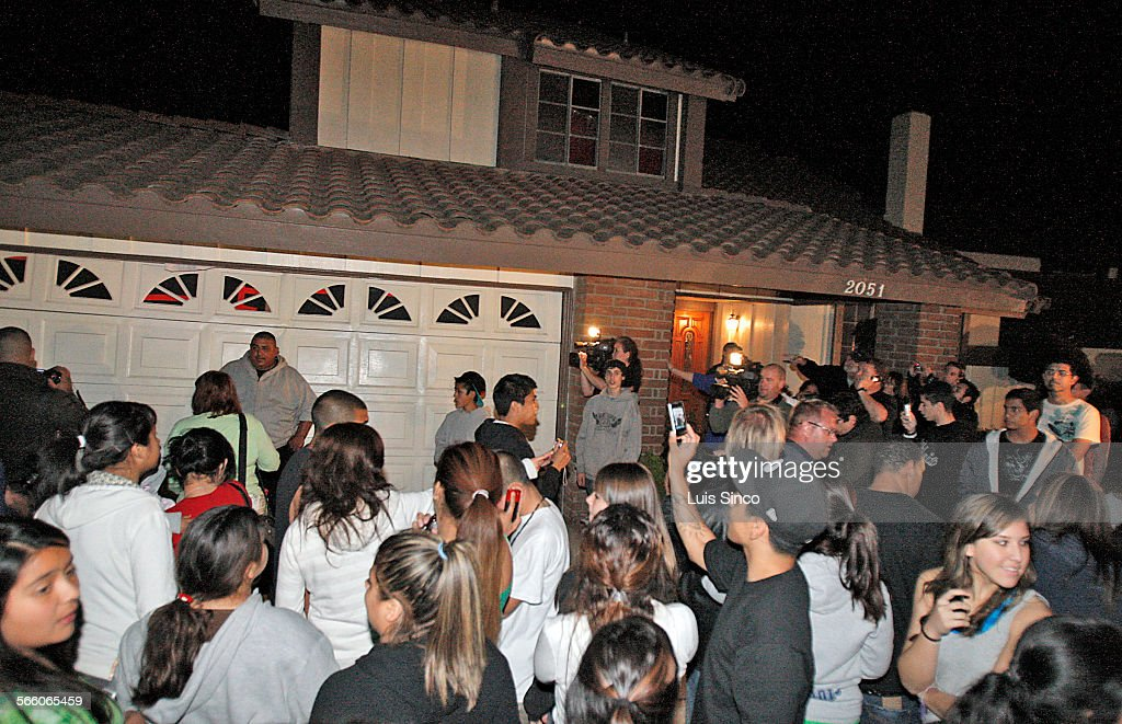 Dozens of people crowd around the La Habra residence of octomom Nadya Suleman after she returned home Tuesday night Mar 17 with two of her octuplets