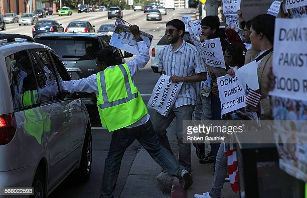 WESTWOOD CA AUGUST 29 2010 – Dozens of people seeking help for Pakistan flood victims demonstrate along Wilshire Blvd where some passing drivers...