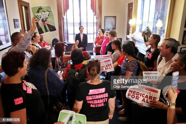 Dozens of people stand in the offices of Sen Marco Rubio while protesting against the Republican health care repeal and replace legislation in the...