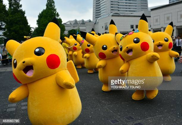 Dozens of Pikachu characters the famous character of Nintendo's videogame software Pokemon parade at the Landmark Plaza shopping mall in Yokohama...