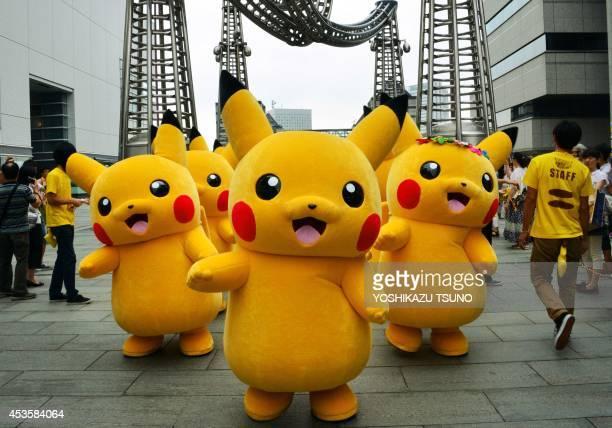 Dozens of Pikachu characters the famous character of Nintendo's videogame software Pokemon parade at the Landmark Plaza shopping mall in Yokohama...