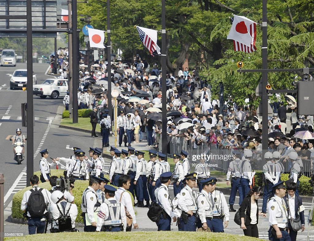 Dozens of police officers are seen standing guard near the Peace Memorial Park in Hiroshima on May 27, 2016, ahead of a visit by U.S. President Barack Obama. Obama became the first sitting U.S. president to visit the atomic-bombed city that day.