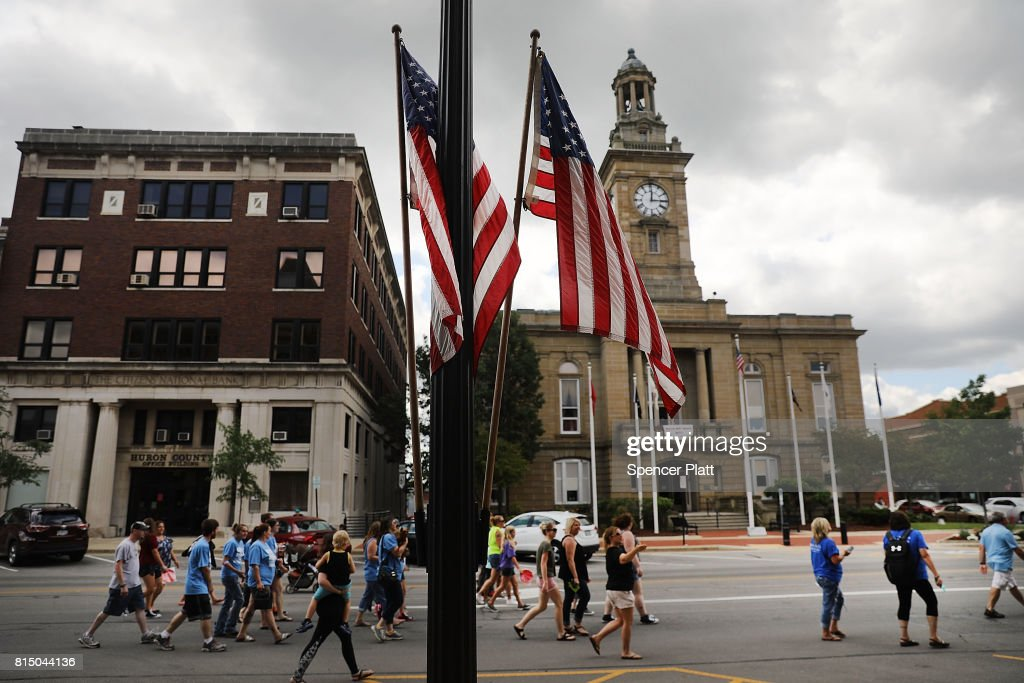 Dozens of residents, activists and recovering addicts march through the streets of Norwalk against the epedemic of heroin in their community on July 14, 2017 in Norwalk, Ohio. The day of action, called Hope Not Heroin, featured a march, speakers, and live bands. According to recent statistics, at least 4,149 Ohioans died from drug overdoses in 2016, a 36 percent leap from just the previous year and making Ohio the leader in the nation's overdose deaths.