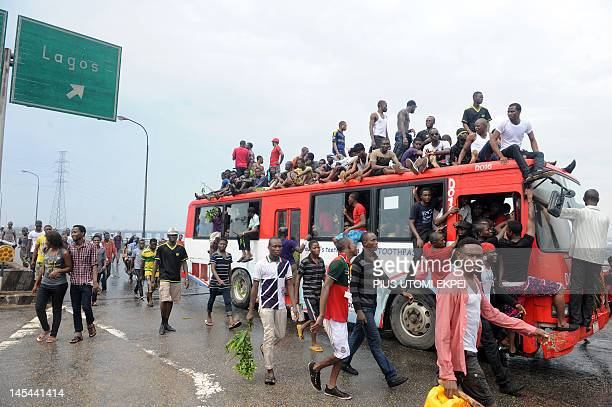 Dozens of students of the University of Lagos sit on a bus on May 30 2012 on Third Mainland bridge in Lagos to protest the name change of their...