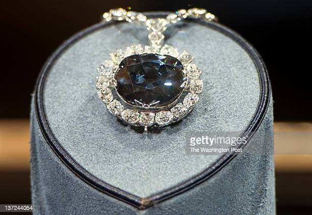 WASHINGTON DC JANUARY 13 Dozens of tourists visit the Harry Winston exhibition Hall to see the Hope diamond with 45 52 carats in the Smithsonian...