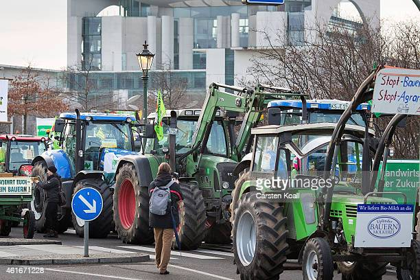Dozens of tractors are parked after farmers from across Germany marched to protest against industrialized agriculture the TTIP trade agreement and...