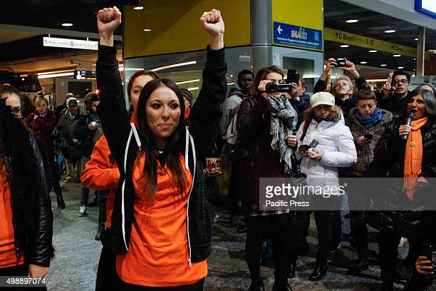 Dozens of women wear something orange a color chosen by ONU as a symbol of a future without violence against women gathered at the train station of...