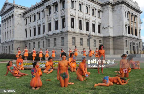 Dozens of women with body paintings take part in a demo in favour of the legalization of abortion in front of the Congress building in Montevideo on...