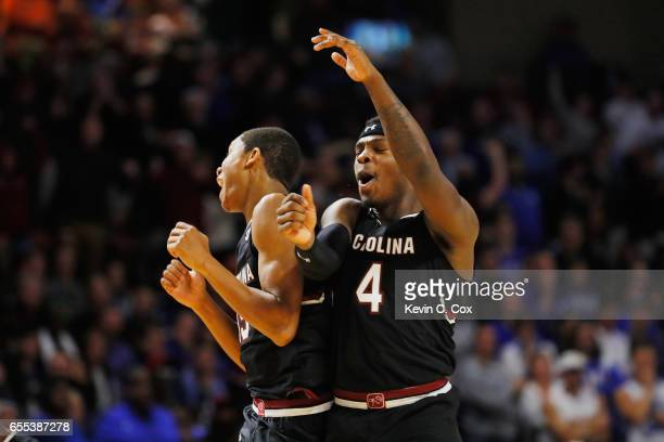 Dozier and Rakym Felder of the South Carolina Gamecocks react in the second half against the Duke Blue Devils during the second round of the 2017...