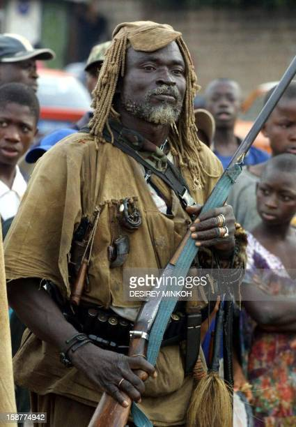 A Dozo hunter holds his rifle during a ceremony organized by these traditional Ivorian hunters allied of the 'New Forces' rebel faction to mark the...
