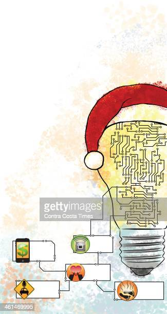 USA 2014 300 dpi Jeff Durham illustration of a light bulb with a Santa hat connected to icons related to tech gifts for use with stories about tech...