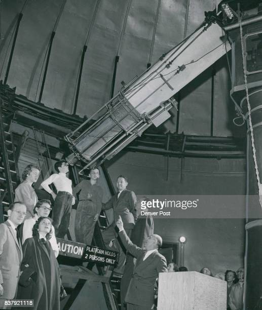 Dr A W Recht Chamberlin observatory director explains the Jorge telescope to a group of 'space travelers' during one of his community college courses...