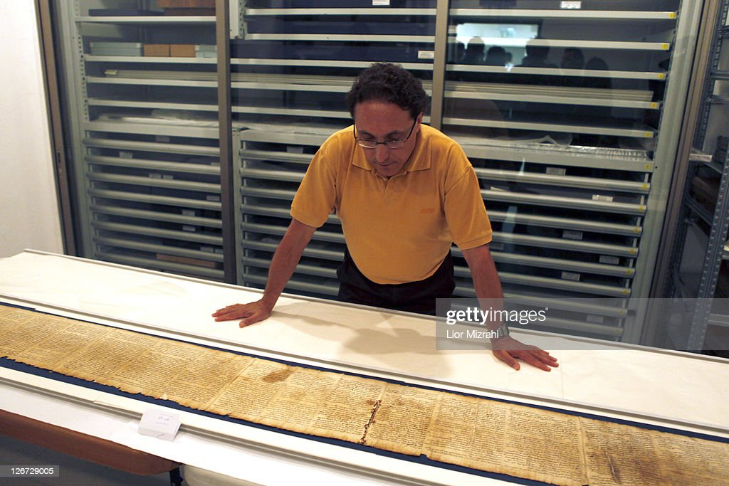 Dr. Adolfo Roitman presents a part of the Isaiah Scroll, one of the Dead Sea Scrolls, inside the vault of the Shrine of the Book building at the Israel Museum on September, 26, 2011. in Jerusalem, Israel. For the first time some of the Dead Sea Scrolls are available online thanks to a partnership between Google and Israel's national museum.
