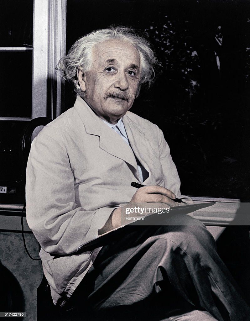 Dr. <a gi-track='captionPersonalityLinkClicked' href=/galleries/search?phrase=Albert+Einstein&family=editorial&specificpeople=70023 ng-click='$event.stopPropagation()'>Albert Einstein</a> is shown seated inside by the window, writing.
