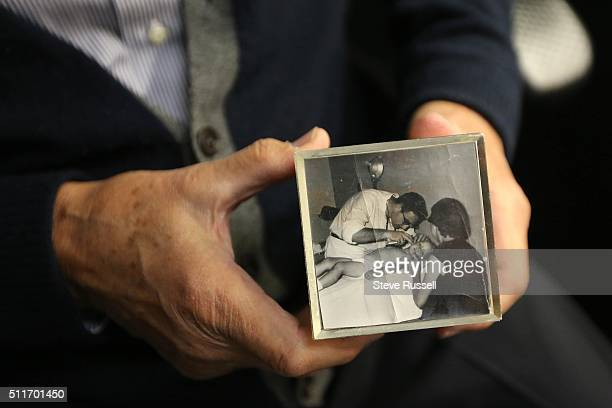 Dr Alvin Zipursky holds a picture cube that includes a photo of him interning In 1959 a young Winnipeg doctor named Dr Alvin Zipursky published an...