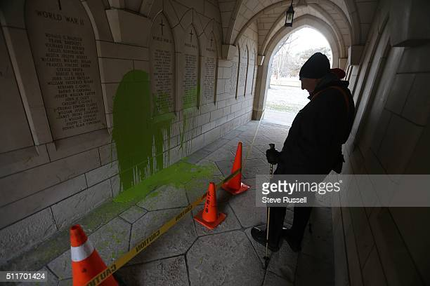 Dr Alvin Zipursky stops to look at a war memorial that has been vandalized as he short cuts through St Michaels at the University of Toronto as he...
