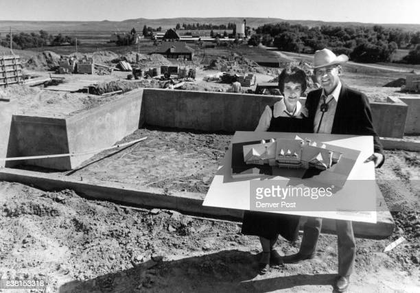 Dr and Mrs J Sloan Hales display scale model of the $650000 mansion they are having built at the Wyoming Hereford Ranch east of Cheyenne Foundation...
