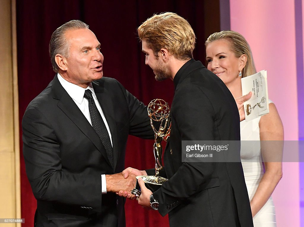 Dr. Andrew P. Ordon, MD (L) and physician Jennifer Ashton present Actor <a gi-track='captionPersonalityLinkClicked' href=/galleries/search?phrase=Bryan+Craig&family=editorial&specificpeople=8088252 ng-click='$event.stopPropagation()'>Bryan Craig</a> an Emmy for Outstanding Younger Actor in A Drama Series on stage at the 43rd Annual Daytime Emmy Awards at the Westin Bonaventure Hotel on May 1, 2016 in Los Angeles, California.