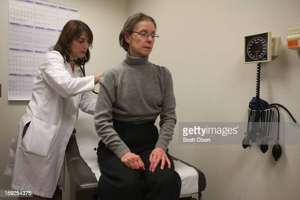 Dr Anne Furey Schultz examines a patient complaining of flulike symptoms at Northwestern Memorial Hospital on January 10 2013 in Chicago City...