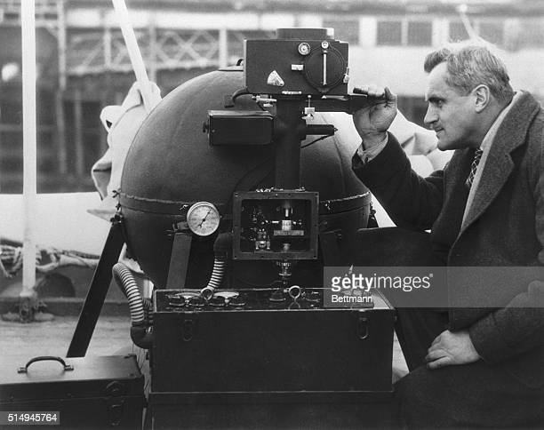 Dr Arthur Compton famous University of Chicago physicist and Nobel Prize winner is pictured with his new cosmic ray meter aboard the Aorangi This is...