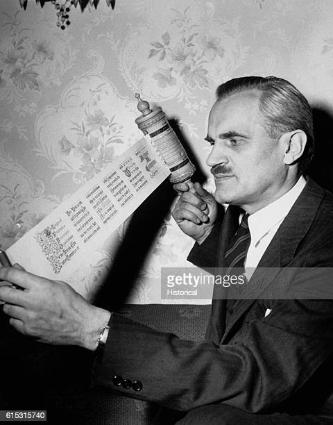Dr Arthur Holly Compton Nobel Prize winning physicist reads the Annual Brotherhood Award scroll he received from the Jewish Education Committee of...