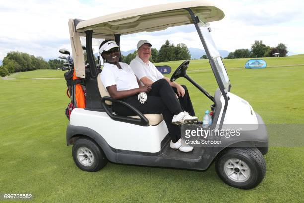 Dr Auma Obama and Gregor Groeger during the 2nd I'm Living Charity Golf Cup at Golfclub Beuerberg on June 16 2017 in Penzberg Germany The proceeds...