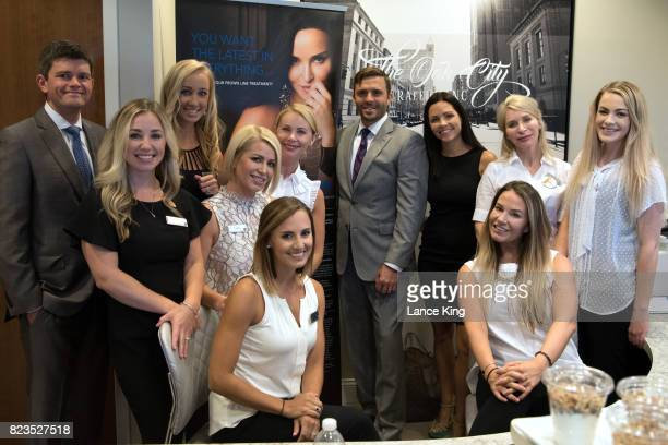Dr Benjamin Wood and Dr Jeremy Pyle pose for a photo with their staff at Davis Pyle Plastic Surgery on July 27 2017 in Raleigh North Carolina